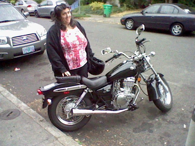 Nicole Ramsey poses next to her sweet motorcycle.