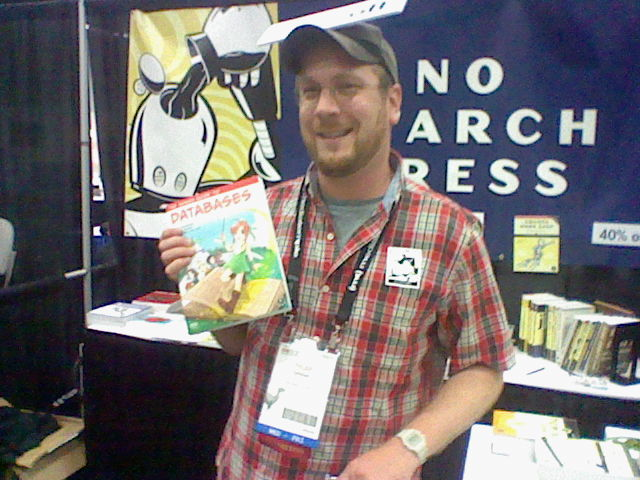 Tyler Ortman of No Starch Press poses next to my copy of the Manga Guide to Databases.